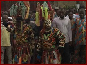 """Two """"female"""" masquerades who were dressed identically and danced together."""