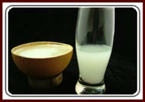 Palm wine in a glass and in a calabash bowl