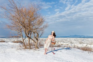 Off Balance, by artist Catherine Rondeau. Surreal photomontage inspired by female adolescence. Evocation of the passage from girlhood to womanhood in a strange dreamlike winter setting.