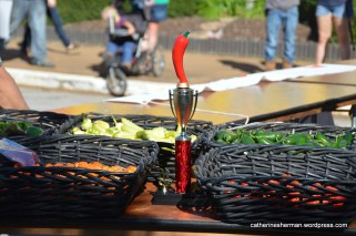 The Hot Pepper Eating Contest trophy with some of the hot peppers in the contest.