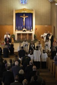 Another view. All of the clergy and pall bearers hold candles.