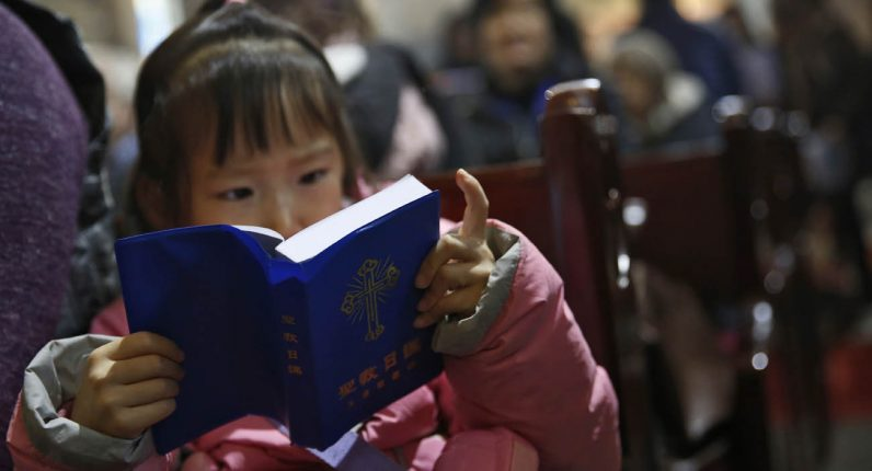 Outside cities Chinese grandparents pass on faith to