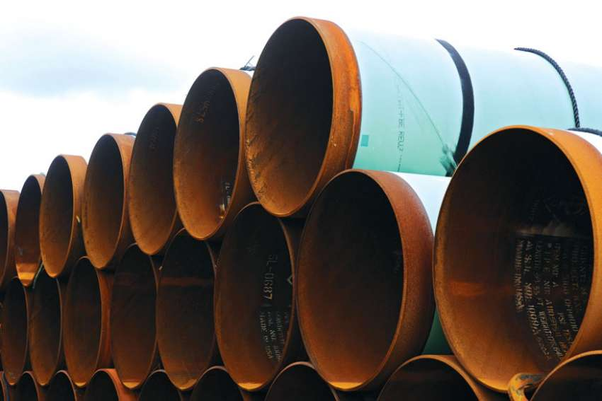 A file photo taken in 2012 shows pipes stacked at a storage yard in the TransCanada Pipe Yard near Cushing, Okla., to be used for the Keystone XL pipeline from Cushing to the Gulf of Mexico. U.S. President Donald Trump reversed his predecessor's decision to kill the pipeline.