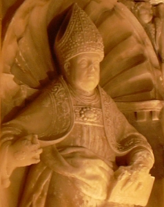 detail of a bas relief of Saint Valerius of Saragossa, Veruela - Sepulcro del abad Lope Marco,  attributed to Pedro de Moreto h. 1552-1553; taken by ecelan on 6 October 2006; swiped from Wikimedia Commons