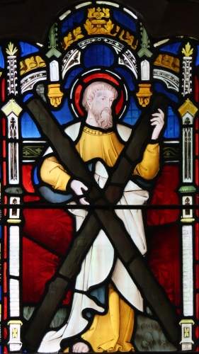 detail of a stained glass window of Saint Andrew the Apostle, date and artist unknown; chancel window, Saint Andrew's Church, Greenssted, Ongar, Essex, England; photographed on 26 June 2015 by Acabashi; swiped from Wikimedia Commons
