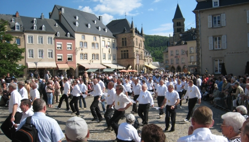Dancers in the Dancing procession of Echternach; photographed on 13 May 2008 by David Edgar; swiped from Wikimedia Commons