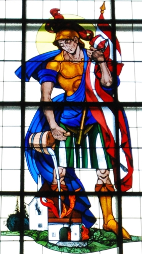 stained glass window of Saint Florian of Lorch, date and artist unknown; church of the Visitation, Lower Hollabrunn, Austria; photographed on 26 November 2011 by GuentherZ; swiped from Wikimedia Commons