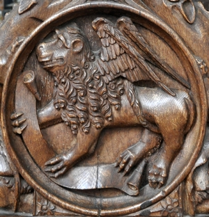 bas-relief of the lion as a symbol of Saint Mark the Evangelist; 1509, artist unknown; choir stall, abbey church, Bordesholm, Schleswig-Holstein, Germany; photographed in October 2014 by Andreas Praefcke; swiped from Wikimedia Commons