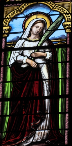 detail of a stained glass window of Saint Alodia, date and artist unknown; church of Saint John the Baptist, Jazeneuil, Vienne, France; photographed on 3 April 2018 by GFreihalter; swiped from Wikimedia Commons