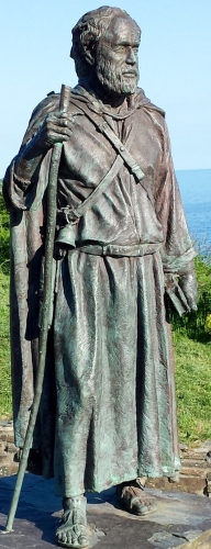 statue of Saint Carannog in Llangrannog, Wales, date and artist unknown; photographed on 23 June 2015 by DeFacto; swiped from Wikimedia Commons