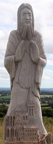 detail of a statue of Blessed Convoyon; by Seenu Shanmugam, date unknown; Carnoët. Vallée des Saints, Brittany, France; photographed on 26 July 2020 by Ggal; swiped from Wikimedia Commons