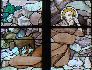 detail of a stained glass window of Saint Enéour, c.1899 by Champigneulle of Paris; north transept of the church of Saint Peter, Plounéour-Trez, Brittany, France; photographed on 15 July 2012 by GO69; swiped from Wikimedia Commons