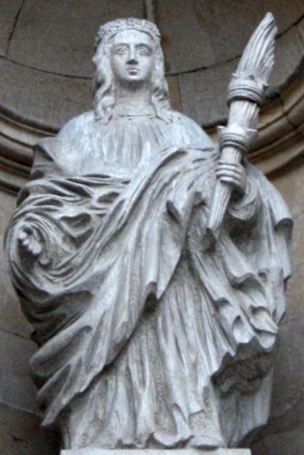 statue of Saint Euphemia, date and artist unknown; facade of the Saint Euphemia church in Orense, Spain; photographed on 1 November 2014 by Po.Lameiro; swiped from Wikimedia Commons