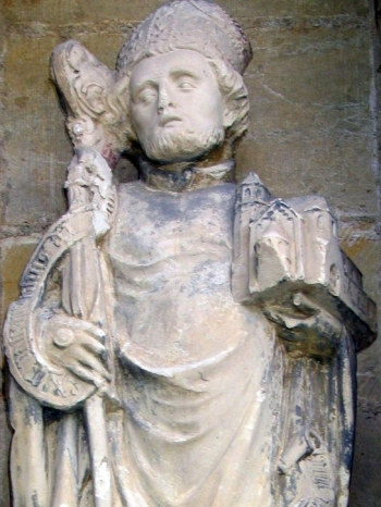 detail of a statue of Saint Godehard of Hildesheim; date unknown, artist unknown; northwest portal, Cathedral of Hildesheim, Germany; photographed on 24 May 2005 by Hildesia; swiped from Wikimedia Commons