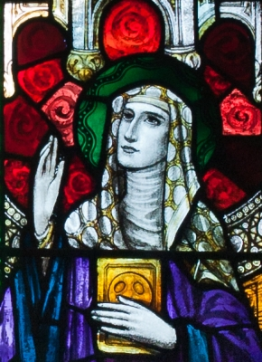 detail of a stained glass window of Saint Íde of Killeedy, east window or the north transept, Church of Our Lady and Saint Kieran, Ballylooby, County Tipperary, Ireland, artist unknown, date unknown; photographed on 8 September 2012 by Andreas F. Borchert; swiped off Wikimedia Commons