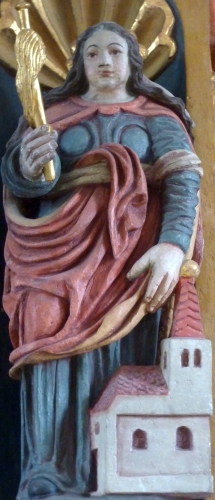 detail of a statue of Saint Lüfthildis; date and artist unknown; altar of the church of Saint Lüfthildis, Kesseling, Germany; photographed on 16 November 2010 by Reinhardhauke; swiped from Wikimedia Commons