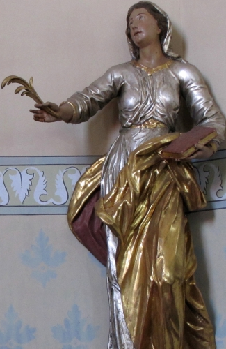detail of a statue of Saint Petronilla; 18th century, artist unknown; church of Saint-Ulrich, Wittersheim, France; photographed on 17 August 2012 by Ralph Hammann; swiped from Wikimedia Commons