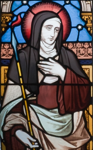 detail of a stained glass window of Saint Teresa of Avila; left left, 7th window, south aisle, Saint Michael's Church, Ballinasloe, County Galway, Ireland; date and artist unknown; photographed on 15 September 2010 by Andreas F. Borchert; swiped frrom Wikimedia Commons