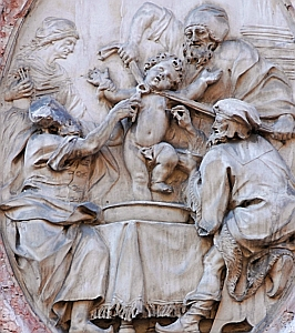 bas-relief of the reputed murder of Simon of Trent on a stone medallion, Palazzo Salvadori, Trent, Italy; date and artist unknown; photographed by Andreas Caranti, 10 February 2007; swiped from Wikimedia Commons