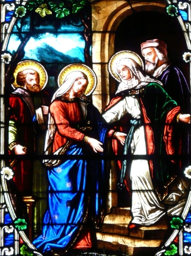 detail of a stained glass representing the Visitation, date and artist unknown; Church of Saint Thomas, Excideuil, Dordogne, France; photographed on 2 March 2010 by Père Igor; swiped from Wikimedia Commons