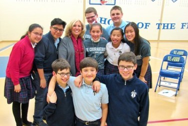 Mrs. Yukich with students at St. Jude rd pix