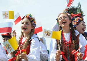 A group of folk dancers rehears prior to the arrival of Pope Francis at the military airport in Krakow, Poland, Wednesday, July 27, 2016. (AP Photo/Alik Keplicz)