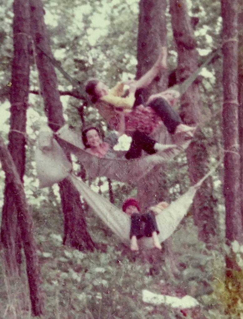 Three kids hang three hammocks in two trees like bunks. CathyKrafve.com