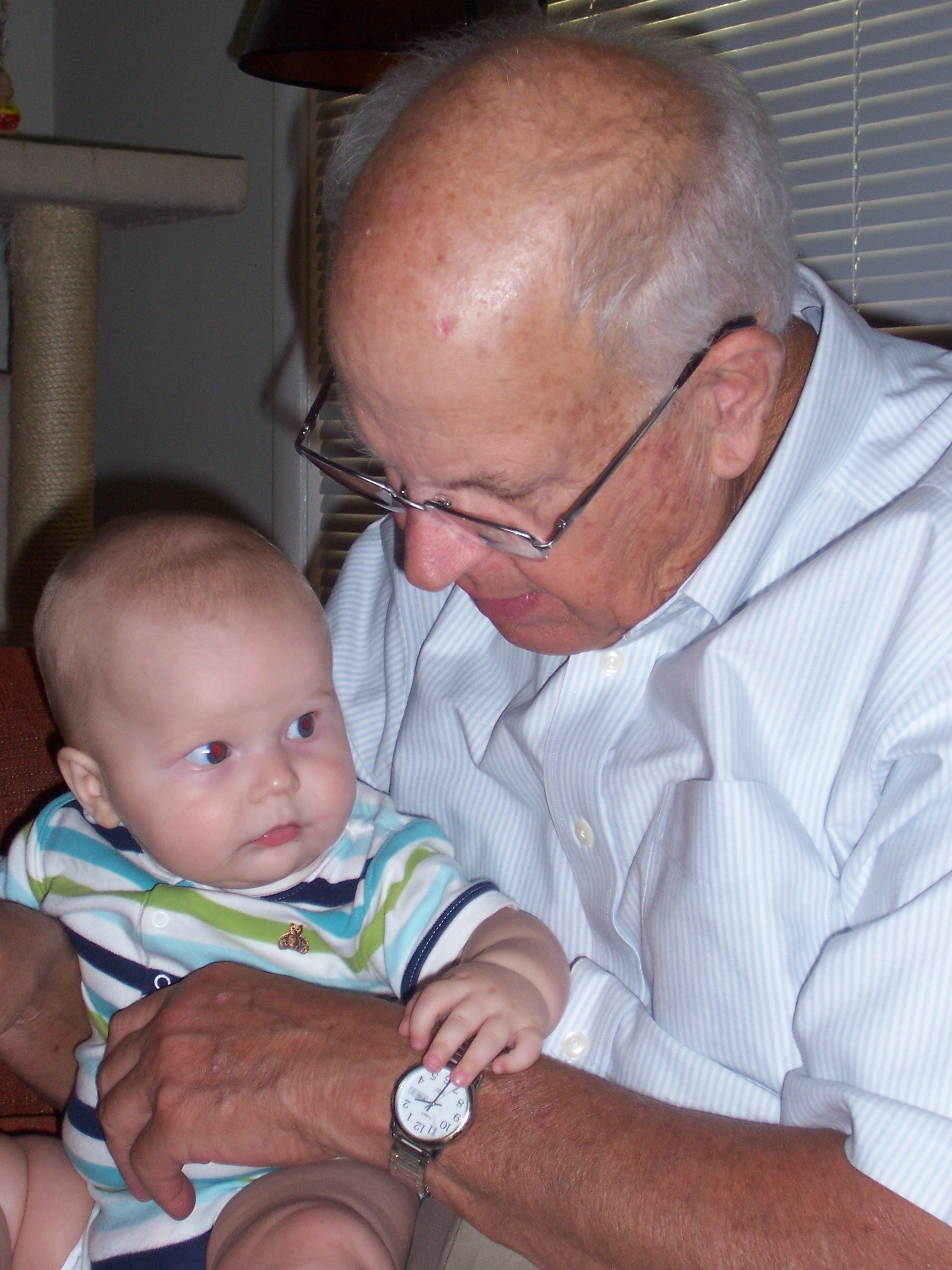 Grandson, 6-month-old Nolan Thomas Behel, learns about watches from his great-grandpa, Ray Wood.