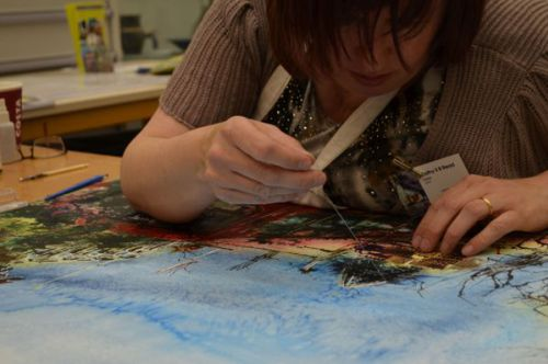 Cathy Read finishing Bus Queue painting-©2015 photo by Irene Foster