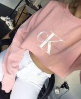 """You're probably sick of the word """"cropped' by now, but I'm sorry, it isn't going away anytime soon. Probably because ANYBODY can make it work, and look snatched! I'm thinking pastel colored, cropped, comfy sweatshirts with name brands on the front are going to be all you see around bonfire this year because they're both comfortable and stylish. (Bonus points if it's an indy or out-of-date brand!)"""