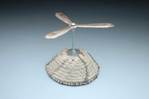 """DUD Object #3"" Condoms, thread, hand fabricated aluminum propellor, armature."