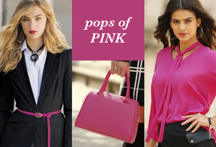 Pops of Pink. A woman with a black and white outfit on with a pop of pink belt and another woman in a pink blouse.