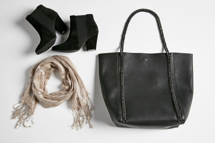 Go with everything final touches. A lay down shot featuring black ankle boots, a metallic scarf and a black tote.
