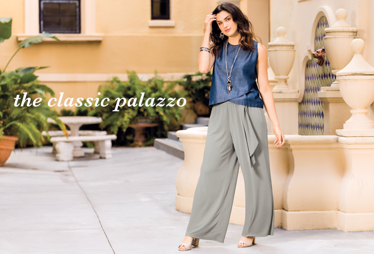 The Classic Palazzo. A beautiful plus size woman wearing a denim sleeveless top and Gray palazzo pants