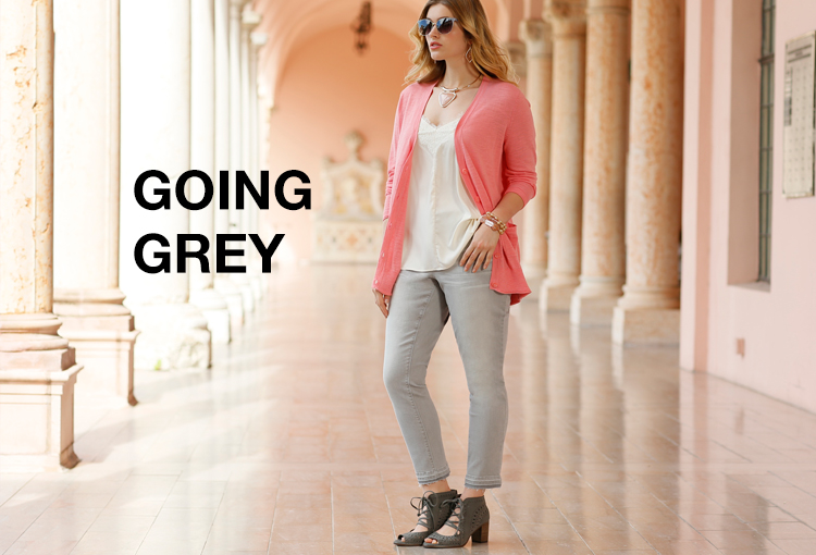 Going Grey. A plus size woman in gray jeans looking fashionable and fabulous