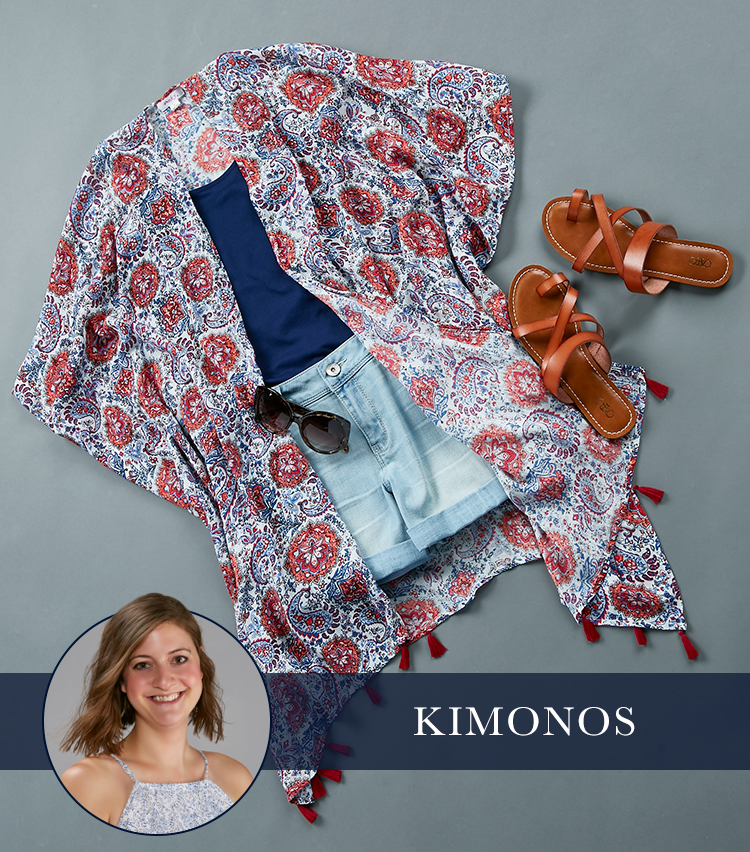 A lay Down shot if a tank, colorful kimono, denim shorts and sandals