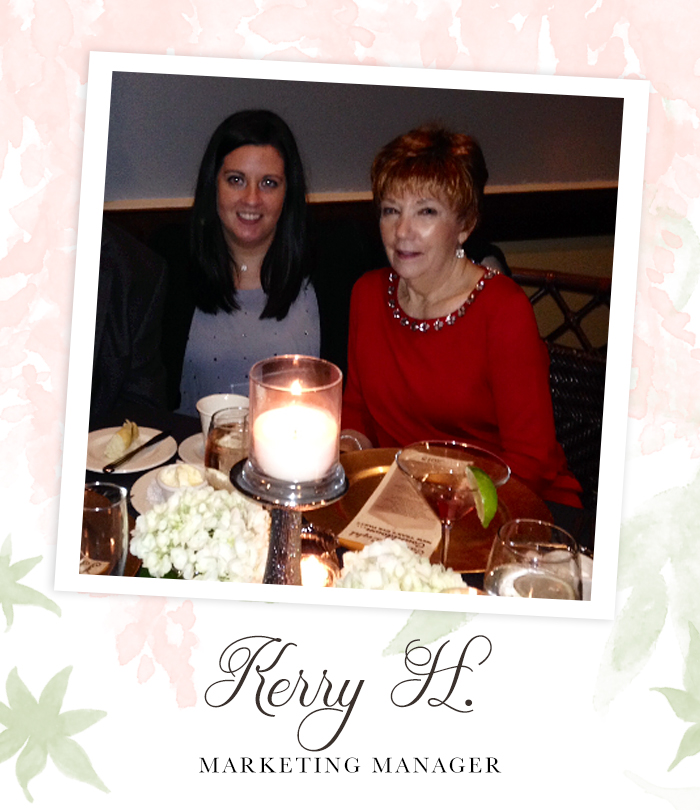 "A Mother and her adult daughter sitting at a table for a nice dinner dressed up and smiling beautifully at the camera.  Captioned, ""Kerry H. Marketing Manager"""