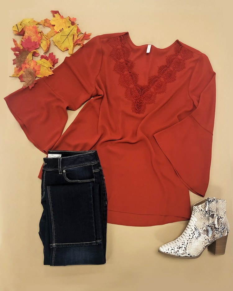 Rust bell sleeve lace v neck top, rinse wash dark blue skinny jeans, and brown and beige western snake print booties