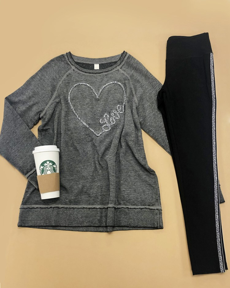 Crew neck vintage blue sweatshirt with love heart design, and black leggings with a white and a gray leopard print stripe down the leg