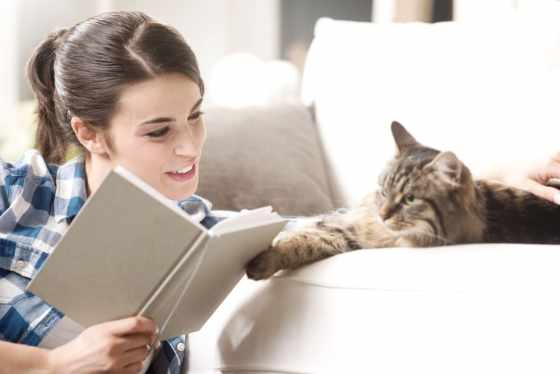 woman studying with cat