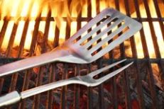 bbq-grill-tools-hot-flaming-cast-iron-grate-close-up-barbecue-party-cookout-concept-57813089