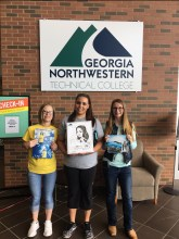 A group of Bobcats pose with their freebies from GNTC's Spring Fling 2017 on the GCC!