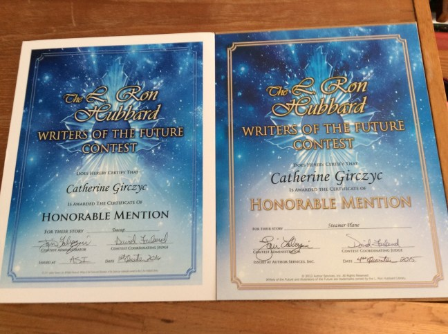 Writers of the Future WOTF Honorable Mention certificates from Cat Girczyc's Bibliography