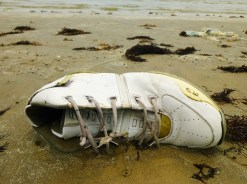 I really like taking pictures of abandoned shoes at the beach.
