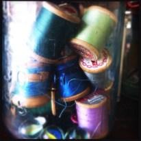 A jar of vintage thread