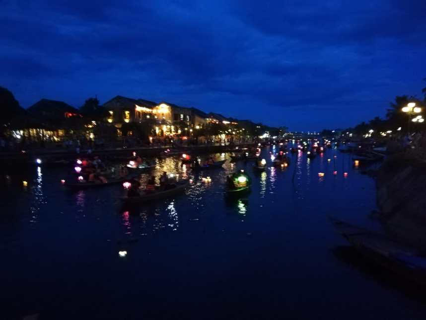 Beautiful lanterns and boats on the river in Hoi An Vietnam at Full Moon Festival
