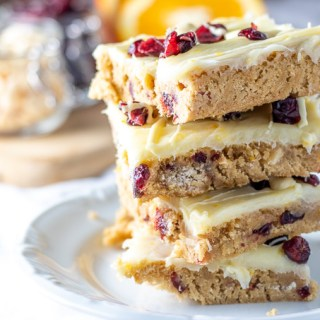 Whether you've tried this treat at a certain coffee shop or not, you're sure to love the creamy, citrusy winter goodness of these cranberry bliss bars!