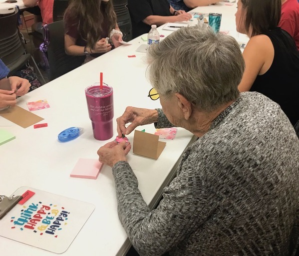 Woman making paper project in craft class