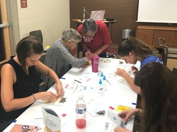 Family working together during craft class