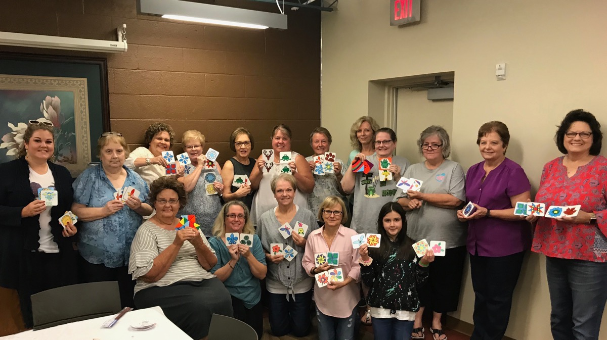 Group of women at craft class on sublimating with markers